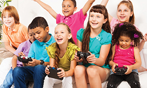 Group of children playing video games.
