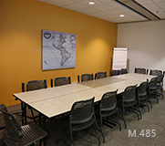 Room M.485 The plan displays tables and chairs forming a rectangle-shaped layout in the centre of the room.